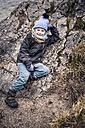 Germany, Bavaria, Ramsau, smiling boy on rock - MJF001441
