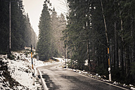 Germany, Bavaria, Ramsau, country road in winter - MJF001453