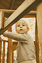 Portrait of toddler leaning at playground equipment - MFF001354