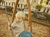 Toddler sitting on a swing - MFF001358
