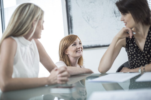 Three businesswomen having a meeting in conference room - ZEF003027