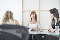 Three businesswomen having a meeting in conference room - ZEF003030