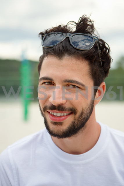 Portrait of smiling young man outdoors - WESTF020728