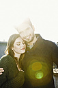Portrait of happy young couple in backlight - MEMF000624