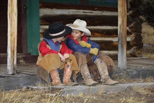 USA, Wyoming, two young cowboys face to face - RUEF001362