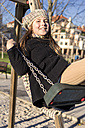 Portrait of smiling girl on a swing - MGOF000011