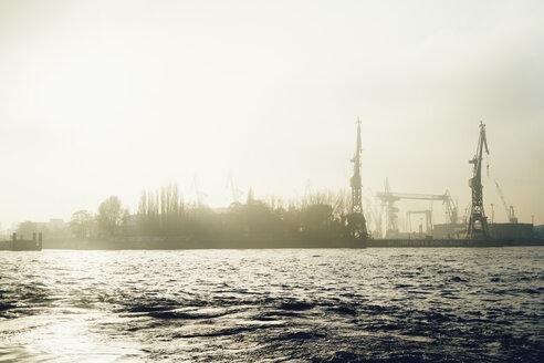 Germany, Hamburg, harbor facility in the evening - KRP001214