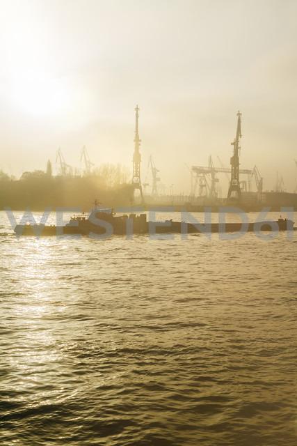 Germany, Hamburg, harbor facility and ship in the evening light - KRP001215