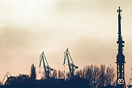 Germany, Hamburg, harbor facility in the evening - KRPF001173