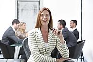 Portrait of confident businesswoman in boardroom - ZEF003114