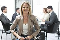 Portrait of confident businesswoman in boardroom - ZEF003116