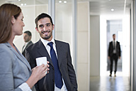 Businessman and businesswoman meeting on office floor - ZEF003124
