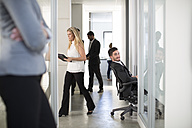 Busy businesspeople on office floor - ZEF003127