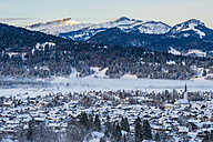 Germany, Bavaria, view to Allgaeu Alps with snow-covered Oberstdorf in the foreground - WG000564