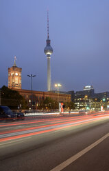 Germany, Berlin, traffic on street, TV tower and Rotes Rathaus at dusk - BFR000844
