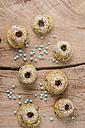 Mini vanilla marble cakes and light blue pearls on wood - ODF001028