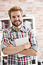 Portrait of confident young man in office - WESTF020646