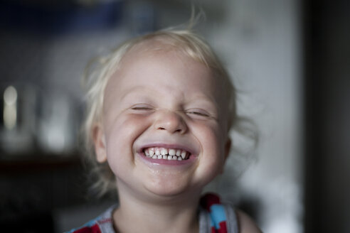 Portrait of laughing little boy with closed eyes - RB002250