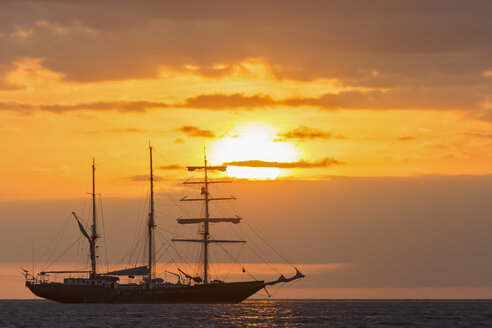 Pacific Ocean, sailing ship at Galapagos Islands at sunset - FOF007553
