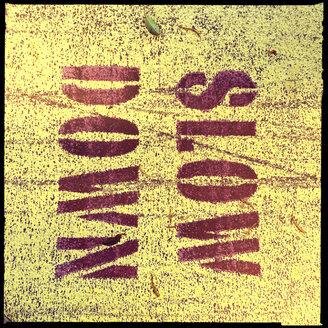 sign, ground, yellow, stencil, slow down, walk, brisbane, queensland, australia - LULF000048
