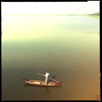 man on taungthaman lake with wooden longtail boat, amarapura, myanmar - LUL000147