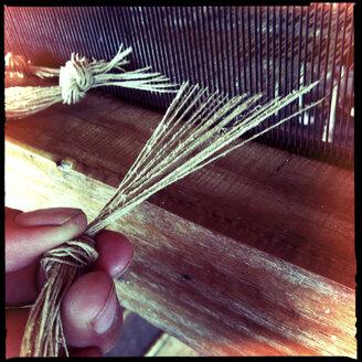 women weaving traditional fabric, inle lake, myanmar - LUL000219