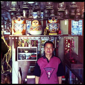 vendor in shop, inle lake, myanmar - LUL000254