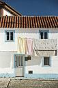Portugal, Centro Region, Nazare, Laundry on clothes line - KBF000287
