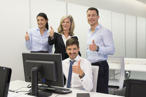 Portrait of confident businesspeople at desk in office - SHKF000177