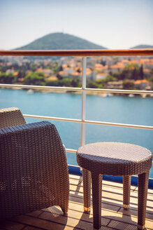 Croatia, Dubrovnik, armchair and side table on deck of a cruise liner - EHF000075