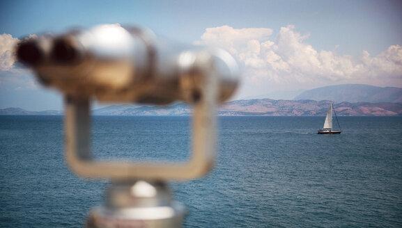Greece, Ionic Islands, Corfu, Binoculars at the sea and a sailing boat - EHF000071