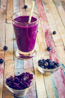 Glass of blueberry beetroot smoothie with chia seeds - SARF001241