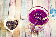 Glass of blueberry beetroot smoothie with chia seeds - SARF001243