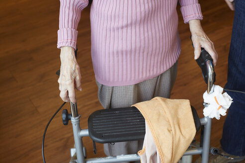 Age demented senior woman with wheeled walker in a nursing home - DHL000526