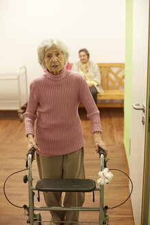 Age demented senior woman with wheeled walker in a nursing home - DHL000515