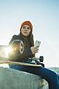 Teenage girl with cell phone in skatepark - UUF003038