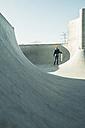 Teenage girl in skatepark - UUF003040