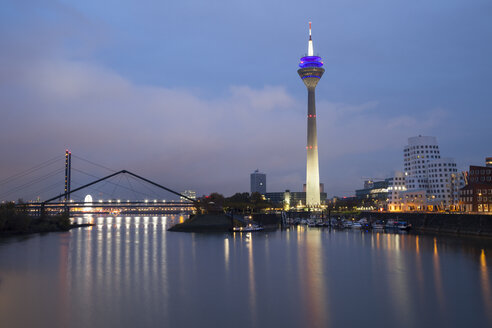 Germany, Duesseldorf, media harbor with Rhine Tower at dusk - WIF001298