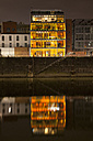 Germany, Duesseldorf, media harbor, glass front of building at night - WIF001315