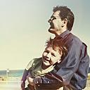 Man holding child on beach, Cronulla, New South Wales, Australia - SBD001644