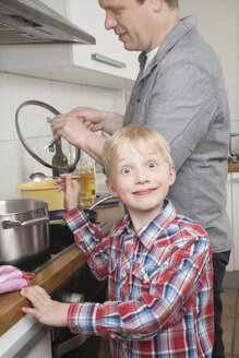 Portrait of boy cooking with his father - PATF000020
