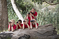 South Africa, Kids on field trip exploring nature, looking through binoculars - ZEF003953