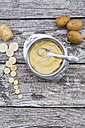 Organic parsnip and potatoes, baby food in bowl, spoon on bright wood - LVF002609