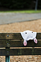 Canada, Vancouver, bunny soft toy on bench - NGF000163