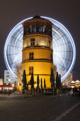 Germany, Duesseldorf, Burgplatz with donjon and ferris wheel at night - WIF001373