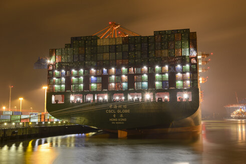 Germany, Hamburg, Container ship Globe at night - RJ000395