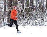 Germany, Baden-Wuerttemberg, Holzberg, man jogging in snow - STSF000688