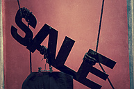 Sale sign in shop window - CSTF000802