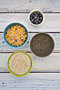 Organic chia seeds and popped amaranth, blueberries and glutenfree cereal in bowls - LVF002651