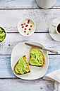 Bread with avocado cream, yogurt with pomegranate seeds and cup of coffee - LVF002661